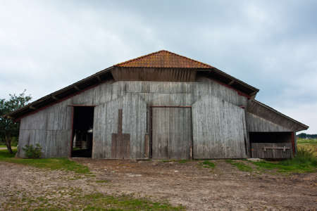 barn door: Old vintage barn in a farm agriculture background image Stock Photo