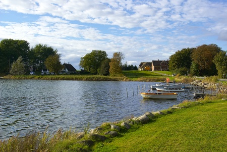 Typical Danish fishermen village Funen Denmark with fishing boats and gear photo