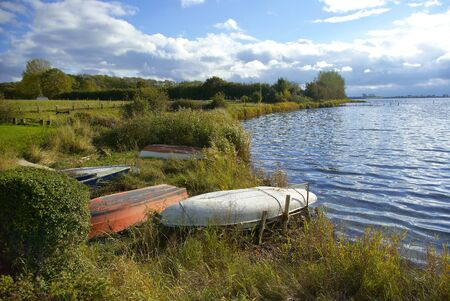 dingy: Small fishing boats by a beautiful lake Funen Denmark
