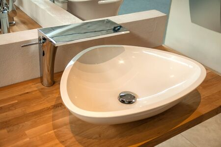 Bathroom interior detail with elegant trendy ultra modern design sink and faucet Stock Photo - 18030933