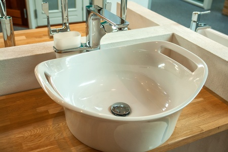 Bathroom interior detail with elegant trendy ultra modern design sink and faucet Stock Photo - 18030945