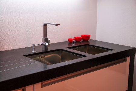 Details of modern design trendy  kitchen sink with water tap faucet Stock Photo - 18061906