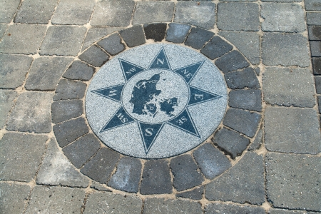 orientate: Beautiful compass directions wind rose made from stone