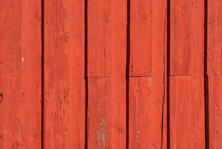 painted wood: Old textured red painted wood pattern surface on a wall background