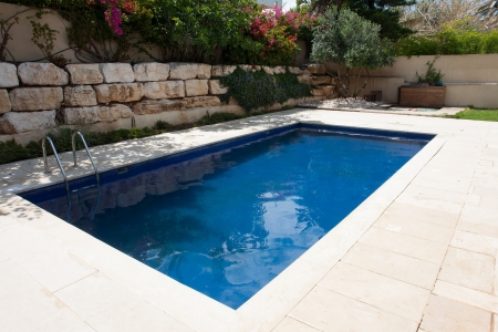 to swim: Modern backyard of a house with a  luxury swimming pool