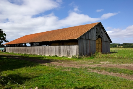Old vintage barn in a farm agriculture background image photo