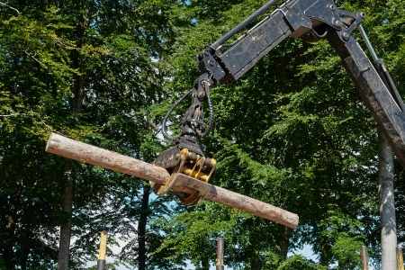Heavy harvester loader truck doing forestry work in the forest with logs Standard-Bild