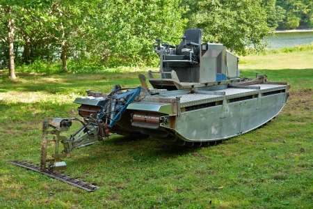amphibious: Amphibious vehicle with cutter trimmer for work in rivers and lakes