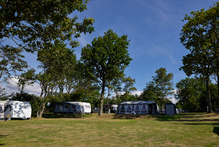 Campers in a beautiful camping site in the middle of nature Stock Photo