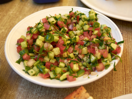sallad: Bowl with classic traditional freshly cut  Israeli salad Stock Photo