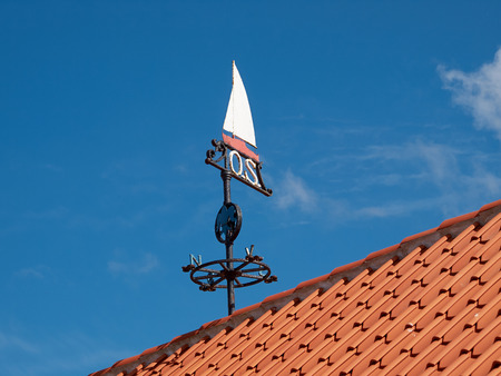 gust: Traditional marine weather vane in a marina port