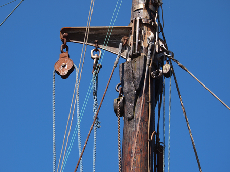 pulley: Pulley for sails and ropes made from wood on an old sail boat