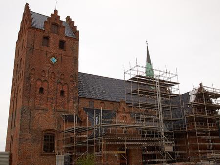 renovate old building facade: Traditional church in Middelfart Denmark under renovation