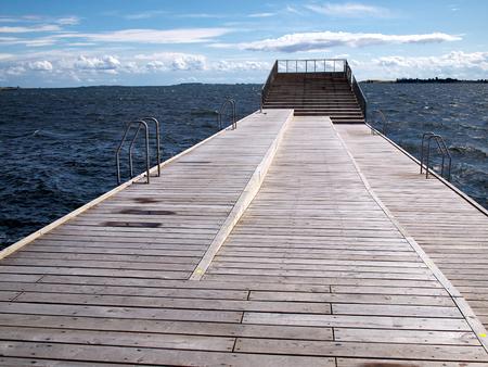 sun bathing: Modern design wooden sun bathing relax deck resort by the ocean Stock Photo