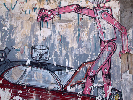 grafiti: Creative funny graffiti of a robot on a wall of old building