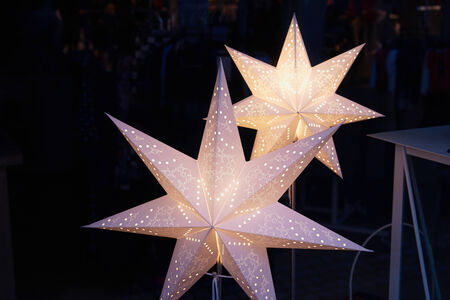 star shaped: White glittering beautiful handmade star shaped Christmas decoration with dark background Stock Photo