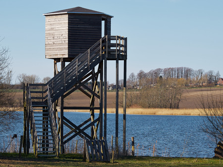 bird watching: Bird watching birding wildlife observation tower in a nature park Stock Photo
