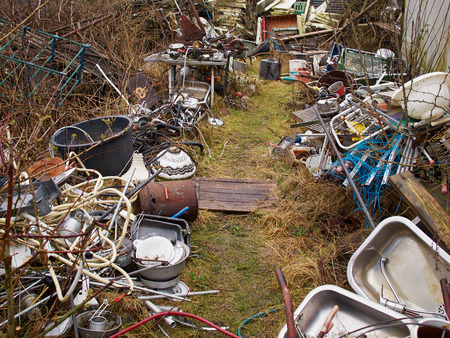 dump yard: Scrap metal iron junk garbage in a backyard