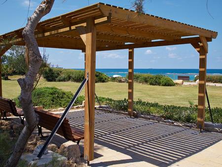 Modern classical design pergola gazebo pavilion in a summer beach coast resort