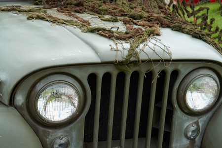 U.S. Army Jeep Front Detail with combat green camouflage net Stock fotó