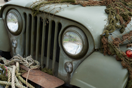 U.S. Army Jeep Front Detail with combat green camouflage net