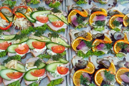 Selection of Smoerrebroed Danish open faced sandwiches on display Standard-Bild