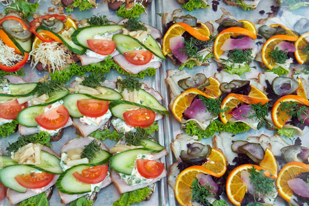 faced: Selection of Smoerrebroed Danish open faced sandwiches on display Stock Photo