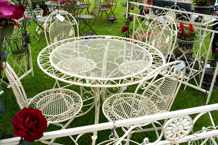 Classical design garden furniture painted in white photo