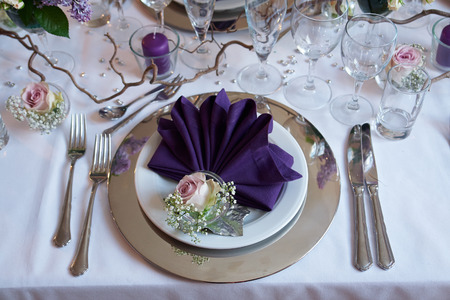 Beautiful festive creative colorful table setting in a restaurant hotel Standard-Bild