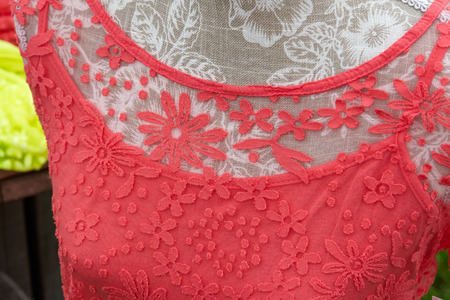 beauty store: Closeup details of a woman fashionable classic red lace blouse shirt
