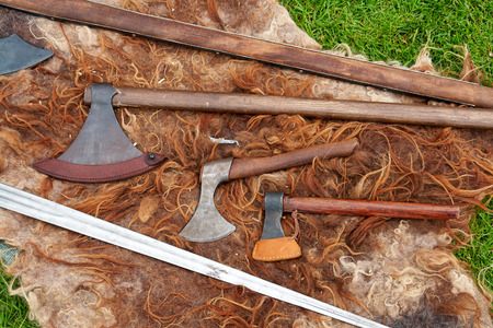Medieval Middle Ages battle axes antique weapons on display