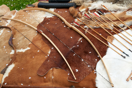 bowstring: Medieval Middle Age weapons traditional bows and arrows in a display