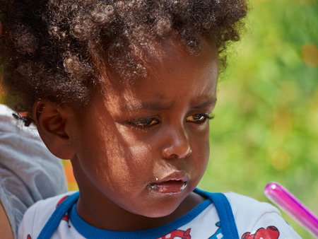 crying boy: Adorable black sad baby crying with bad mood Stock Photo