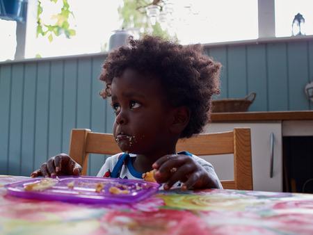 bad mood: Adorable black sad baby crying with bad mood Stock Photo