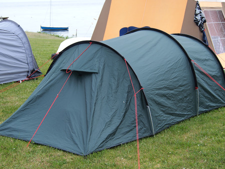 camping site: City of colorful tents in a sea beach camping site village