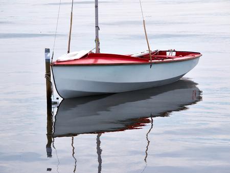 sailboats: Small sailboat moored at sea great sports activity Stock Photo