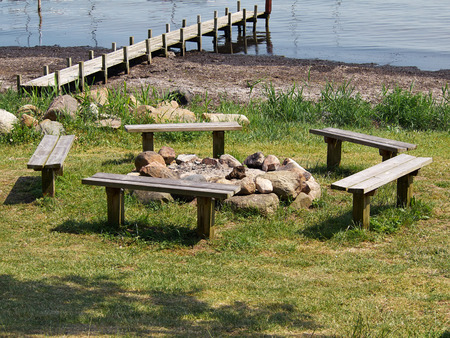the great outdoors: Gathering seating  place around the campfire bonfire for great outdoors activity