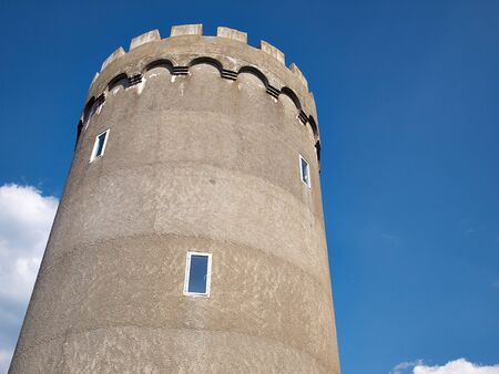 water tower: Old concrete city water tower with clear blue sky background Stock Photo