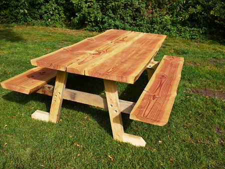 camping site: Rustic style Picnic Table made of wood in a camping site