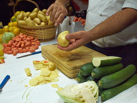 cutting vegetables: Vegetables on cutting board and chef cutting them for a soup Stock Photo
