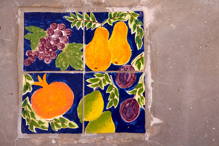 pained: Creative hand pained ceramic tiles with a selection of fruit