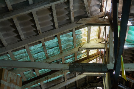 damaged roof: Old damaged roof ceiling of a vintage abandoned house Stock Photo