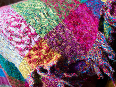 hand woven: Colorful ethnic hand woven fabric material cloth on display in a market Stock Photo