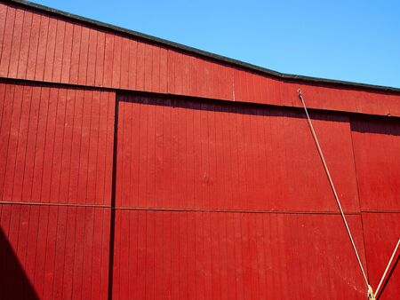 old red barn: Red old vintage barn in a farm agriculture background image Stock Photo