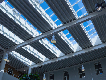 aluminium: Glass roof of modern building with background of clear blue sky