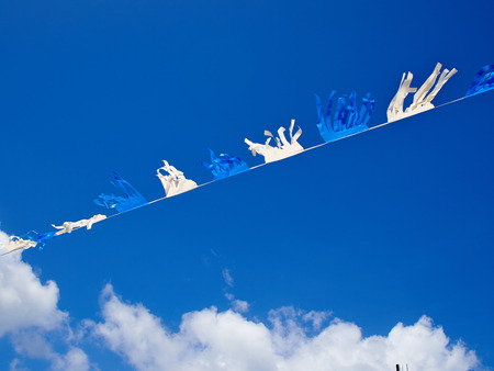 yom: Israel flags on a chain with clear sky to mark and celebrate Israels Independence Day (Yom Haatzmaut)