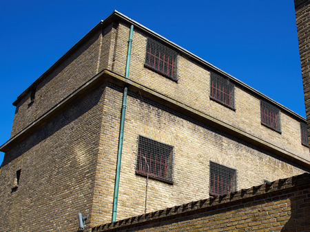 slammer: Old prison jail and windows with heavy iron bars Stock Photo