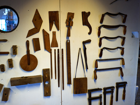creative tools: Old vintage workshop with big selection of hand tools for creative work