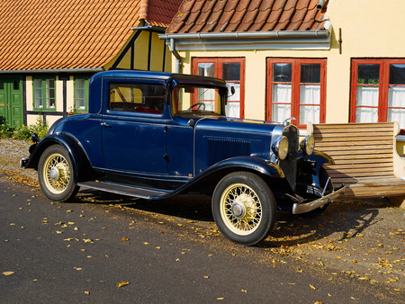 Old timer antique vintage American made car in classic style painted blue Editorial