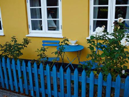 porch scene: Vintage old fashioned classical design typical cafe chairs with table by a house Denmark